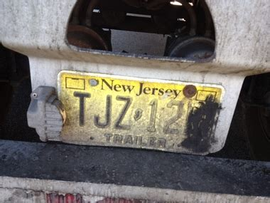 Truck driver accused of tampering with his license plates